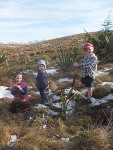 Charlotte, George and Henry planting trees in mid winter at Newhaven